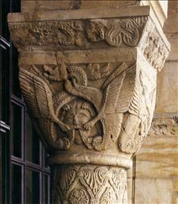 Capital with mask and dragons